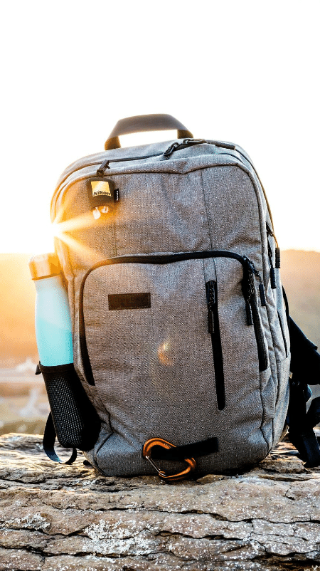 Grey backpack with blue water bottle